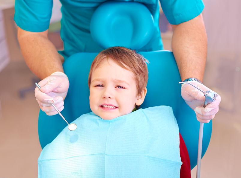 boy sitting in dentist's chair